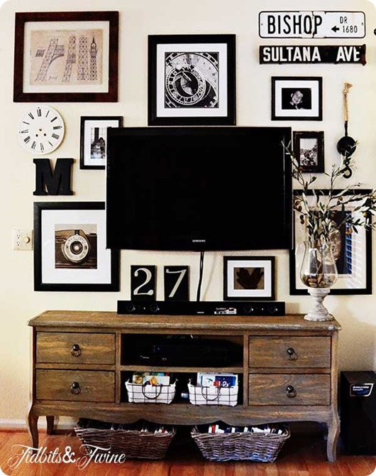 This tv gallery wall is put together with printables and frames that are all pottery barn inspired