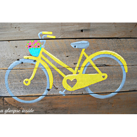"""A Glimpse Inside...""""Life's an Adventure"""" Pallet Art - a vibrant yellow bicycle painted on a reclaimed stained pallet"""