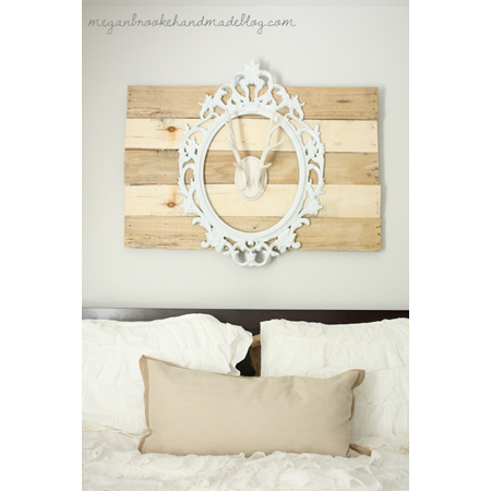 Megan Brooke Handmade created this faux antler pallet wall art with a reclaimed mirror frame
