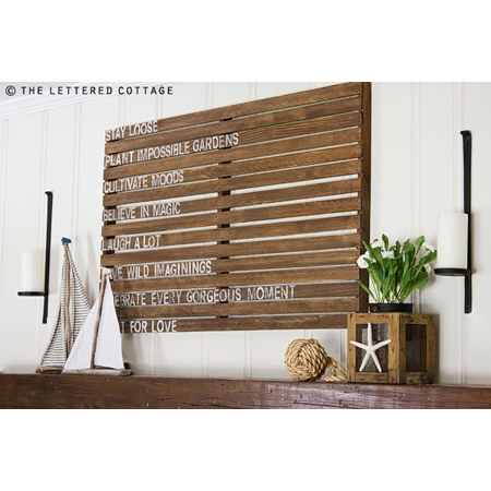 The Lettered Cottage made this inspirational pallet wall art that is just simply grand on this living room wall