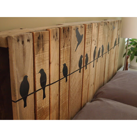 Cathey with an E made this pallet headboard with adorable stenciled birds