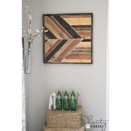 Shanty 2 Chic made this gorgeous pallet wall art with a few different shades of wood stain