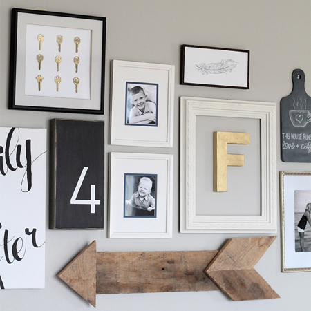 Love Grows Wild added this wooden arrow made from refurbished pallets to their gallery wall for a rustic touch