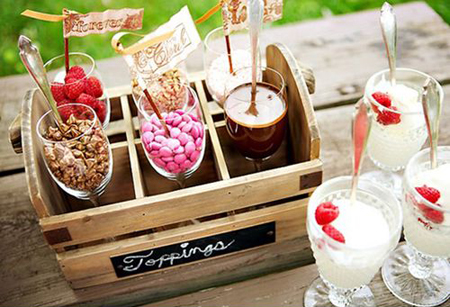 Add some fun to your graduation party with a build your own ice cream sundae bar with toppings like M&Ms, pecans, chocolate syrup and more