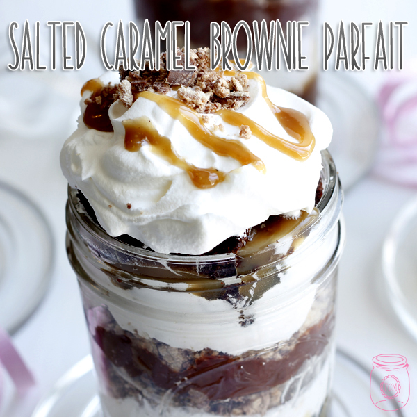 This salted caramel brownie parfait is layered with chocolate and whipped cream.