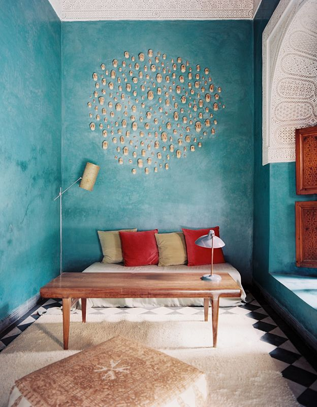 This amazing aqua accent wall makes this space inviting and bright