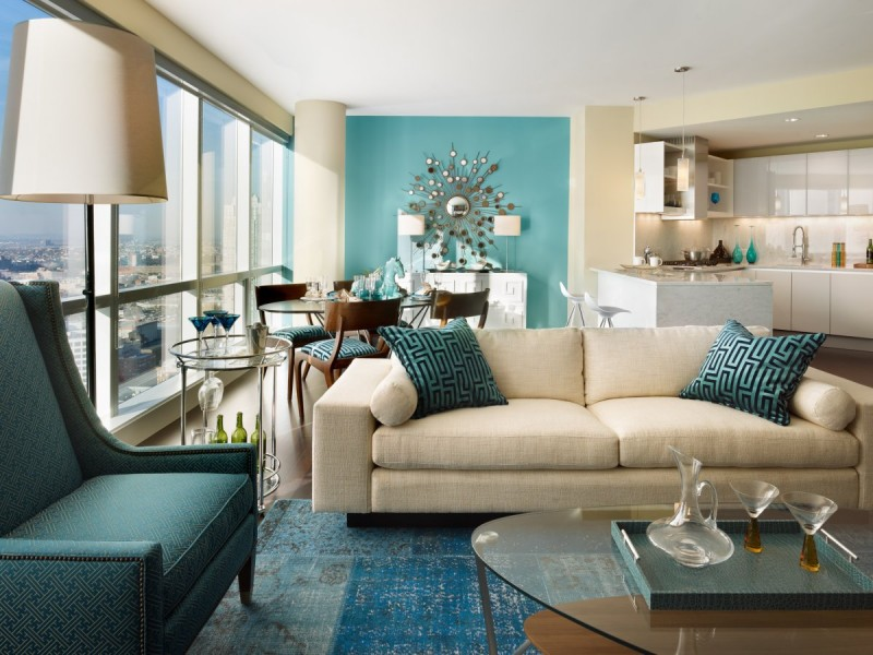 This modern and elegant living room uses different shades of aqua paired with black and creme for a gorgeous combination