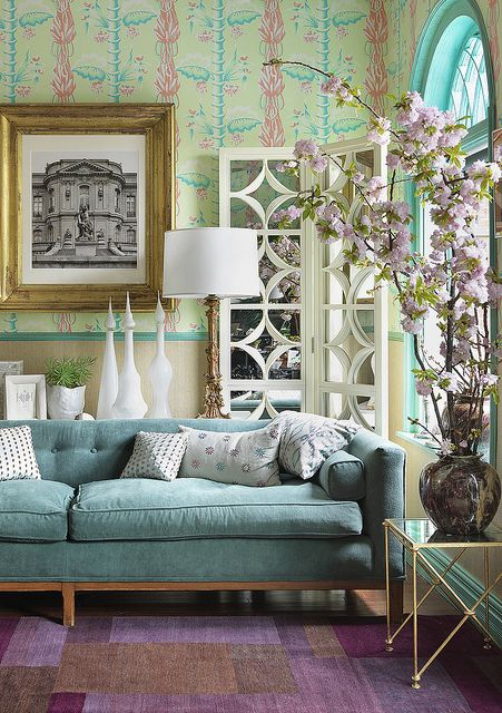 The centerpiece of this room is the gorgeous aqua couch, but other shade of aqua and sea green complement each other