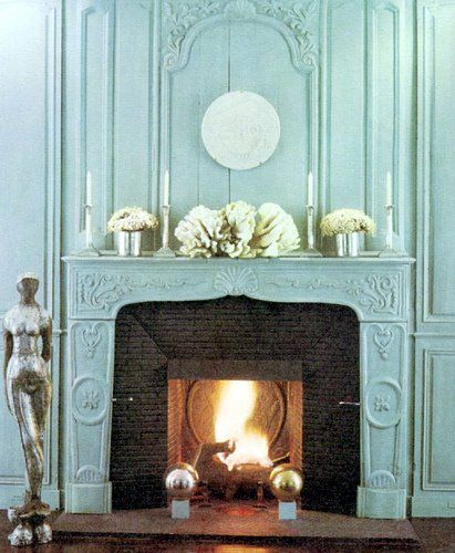 This stunning aqua fireplace is elegant and grand!