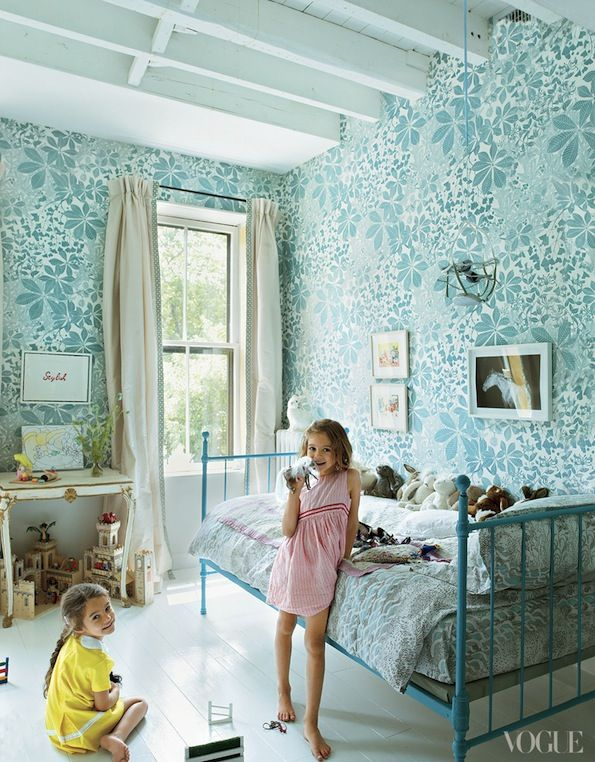 The floral aqua wallpaper in this kids room is fun and bright