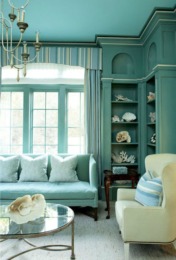 This living room as a coastal theme with all-aqua decor and sea shells everywhere