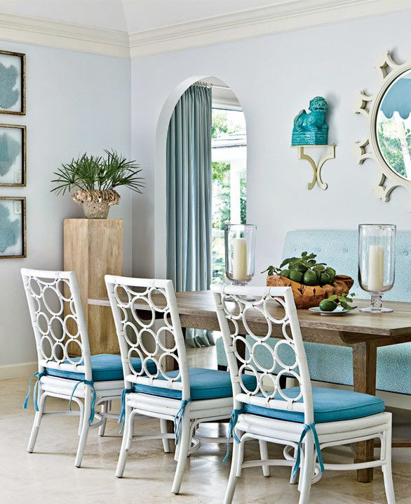 All the different shades of aqua and blue in this dining room are subtle but sweet