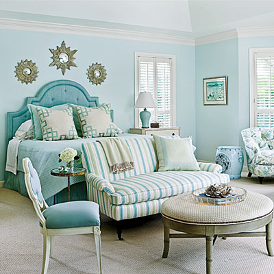 this gorgeous coastal themed room brings the beach inside with different shades of aqua, tan and gold