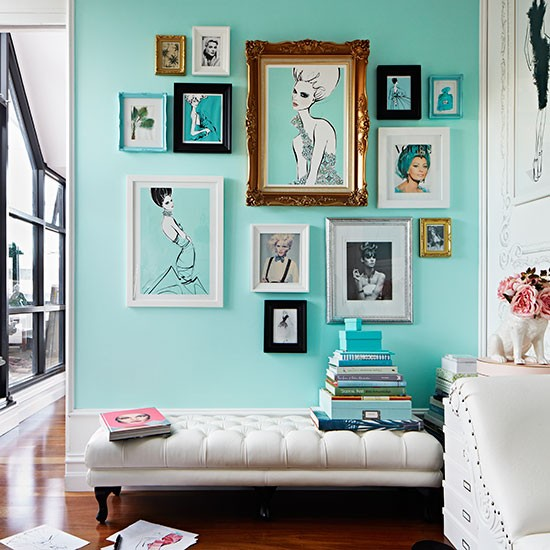 this tiffany blue wall decorated with stunning artwork is perfect for a modern girl