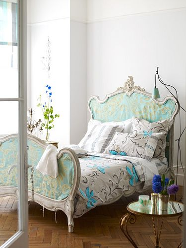 This victorian style headboard has aqua and gold fabric