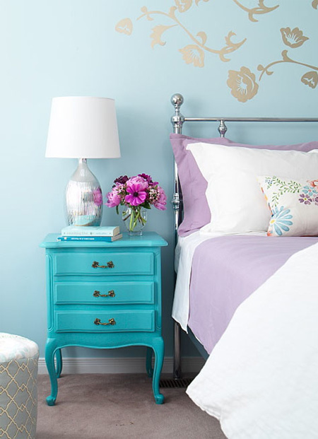 this adorable aqua night stand pairs perfectly with the pops of purple in the bedroom