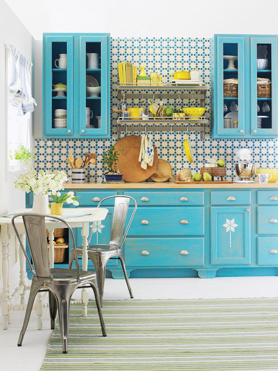 This gorgeous kitchen pairs aqua with yellow and white for a bright and fun style