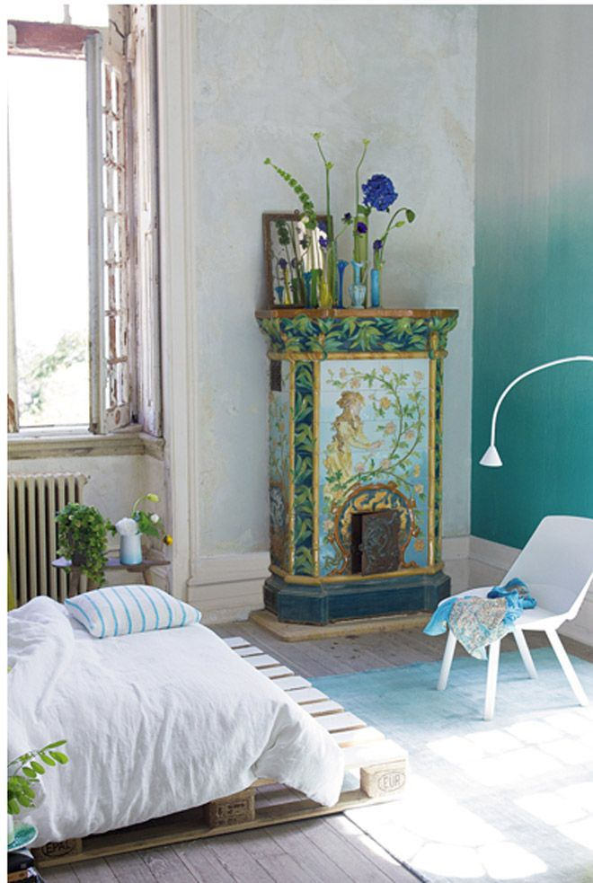 This gorgeous countryside style bedroom has an ombre aqua wall - brilliant!