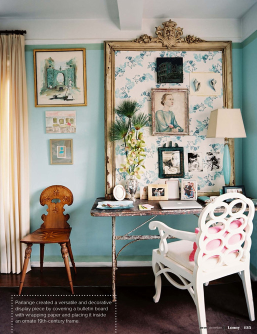 The vintage elements in this room, like the bulletin board and metal desk pair well with the bright aqua colored wall