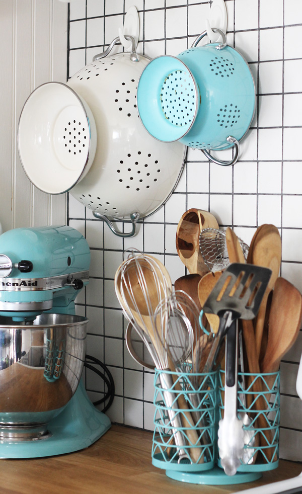 Little touches of aqua add personality and spunk to this kitchen