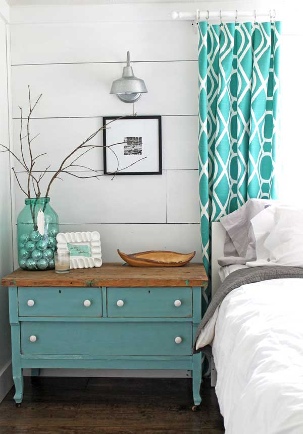 From the modern curtains to the vintage bedside table, this is a perfect example of aqua decor