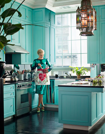 This aqua kitchen as a ton of personality with all-aqua cabinets and bold black counter tops