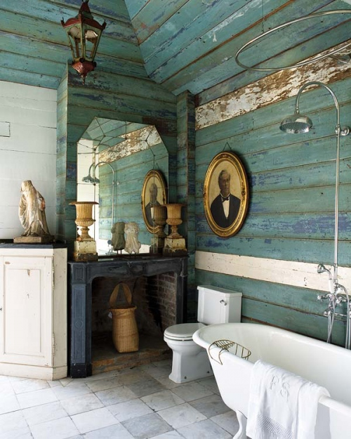 This farmhouse style bathroom has aqua weathered wood walls