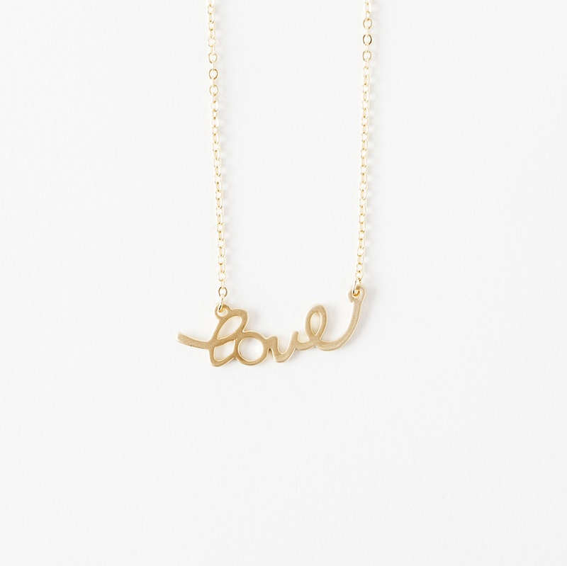 What girl doesn't love an adorable script necklace?
