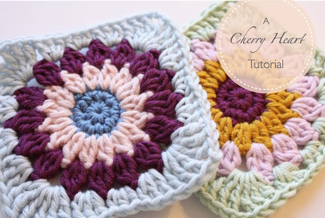 These cherry heart granny squares are crocheted different colors that compliment each other.