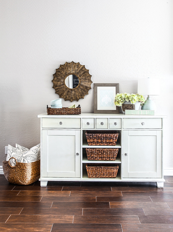 This IKEA dresser is a gorgeous hallway storage center with woven baskets and cute accessories