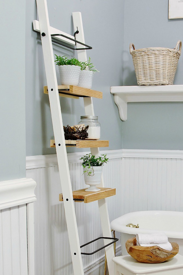 A simple towel holder turned into this cute bathroom decorative shelf