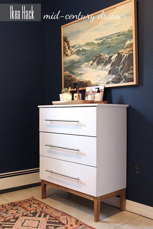 You would never guess that this sleek white dresser was a simple IKEA dresser before this makeover
