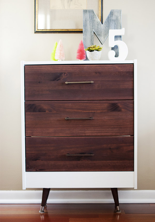 The dark wood stain and sleek hardware on this IKEA dresser give it a stunning modern look