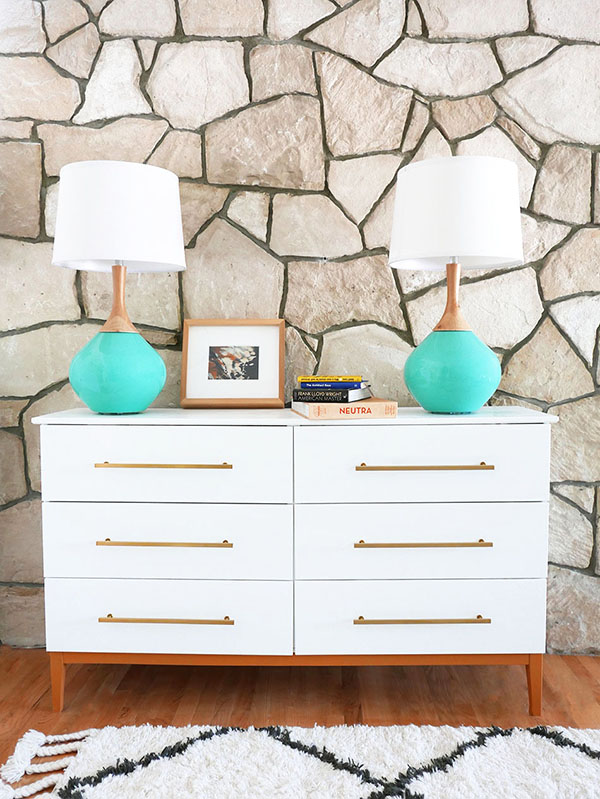 This double IKEA dresser looks simple and stunning with white paint and sleek gold hardware