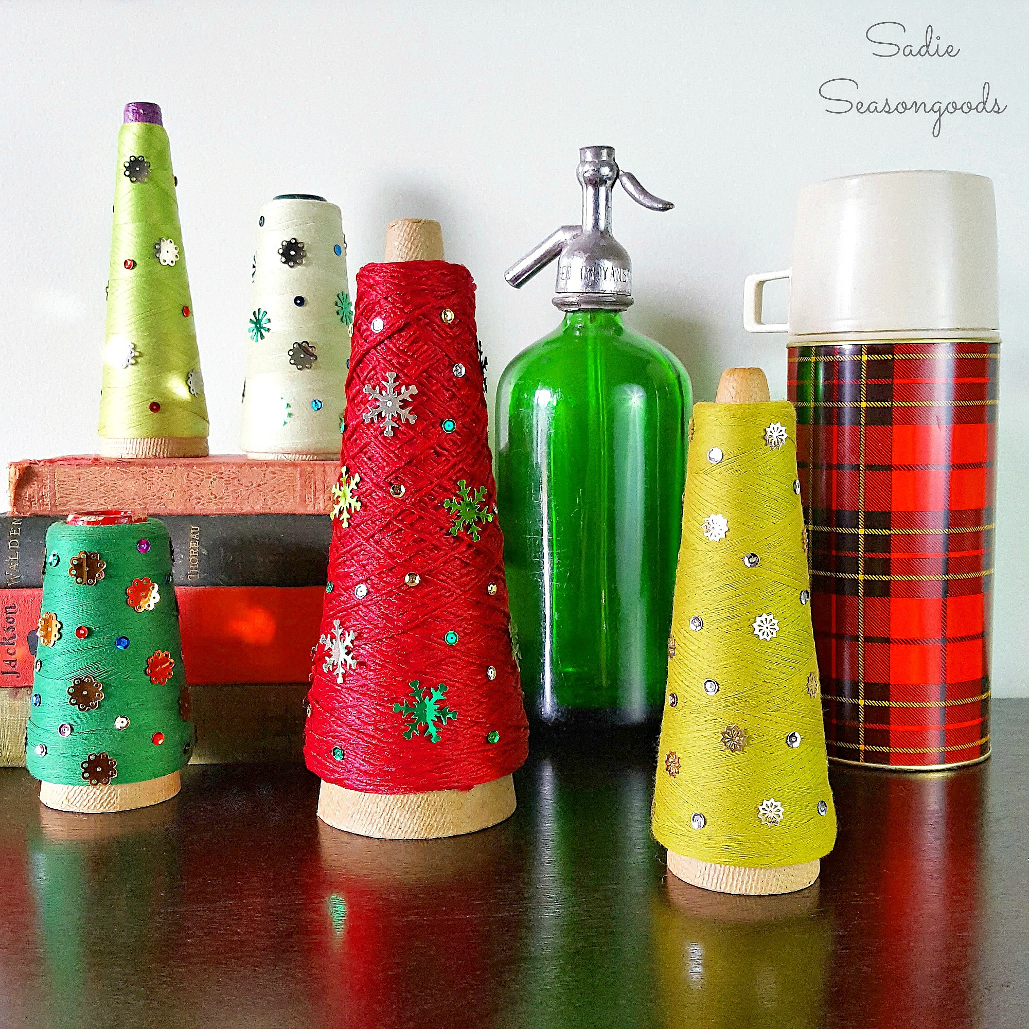 Vintage_serger_cone_thread_repurposed_and_upcycled_as_DIY_Christmas_trees_with_vintage_sequins_holiday_decor_by_Sadie_Seasongoods