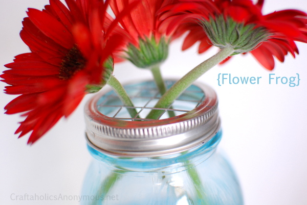 This mason jar as a vase for flowers is unexpected and looks so cute.