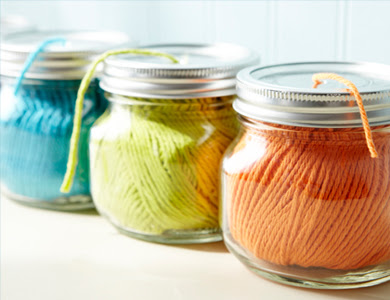 Using mason jars to organize your string in your craft room is a great idea.