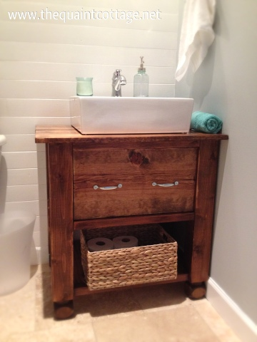 This refurbished vintage wood cabinet makes for the perfect bathroom vanity.