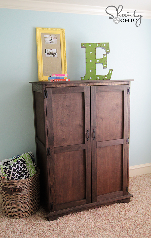This wooden cabinet made with plywood and stained dark is great storage.