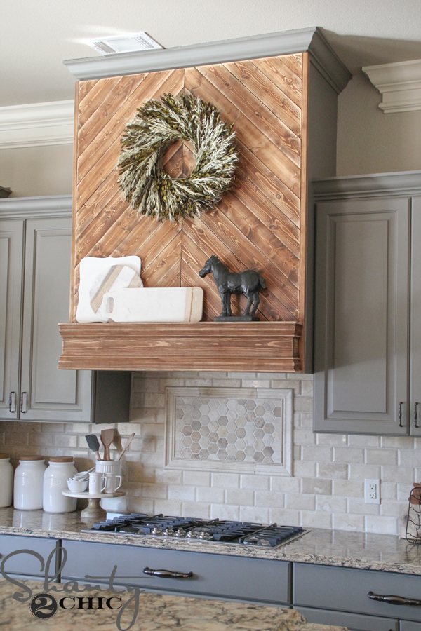This vent hood made of plywood is a statement farmhouse design element.