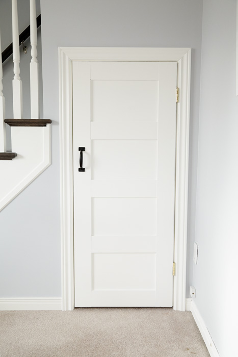 This simple white door with panels adds a cute farmhouse flair.