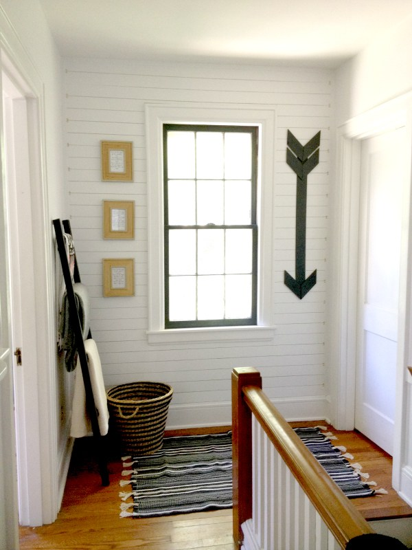This accent wall made of plywood strips adds interest and farmhouse style to the home.