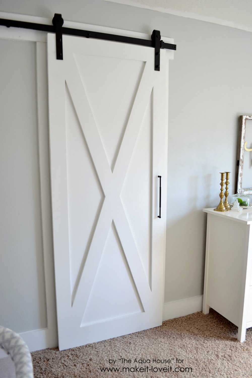 This interesting plywood sliding closet door is farmhouse and industrial too.