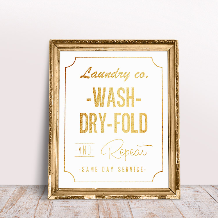 White background with gold text - free printable laundry room wall art