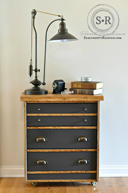 These vintage drawers work well with the wood accents, antique lamp, and books.
