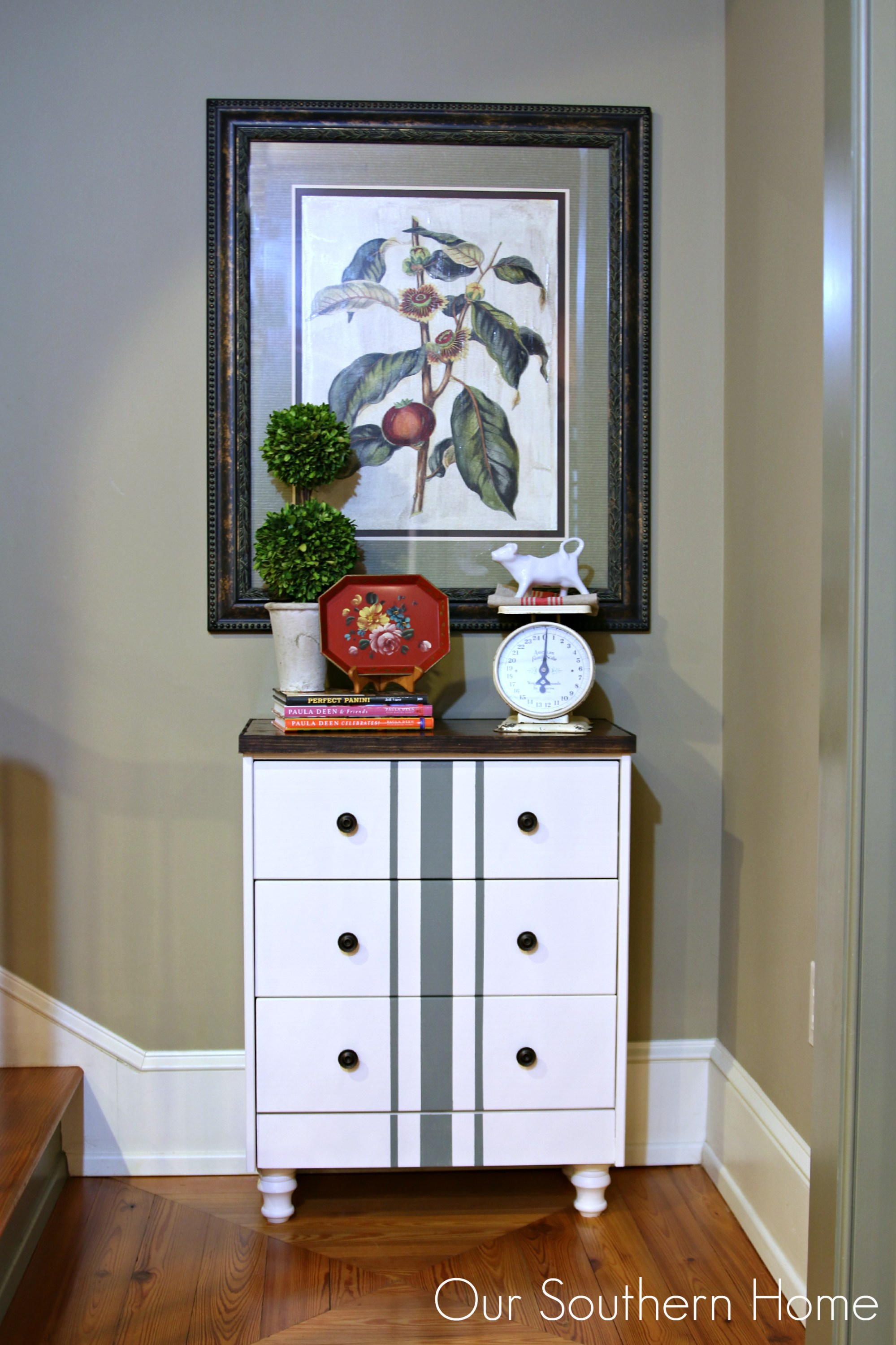 This farmhouse style chest painted white with a stripe accent is also modern.
