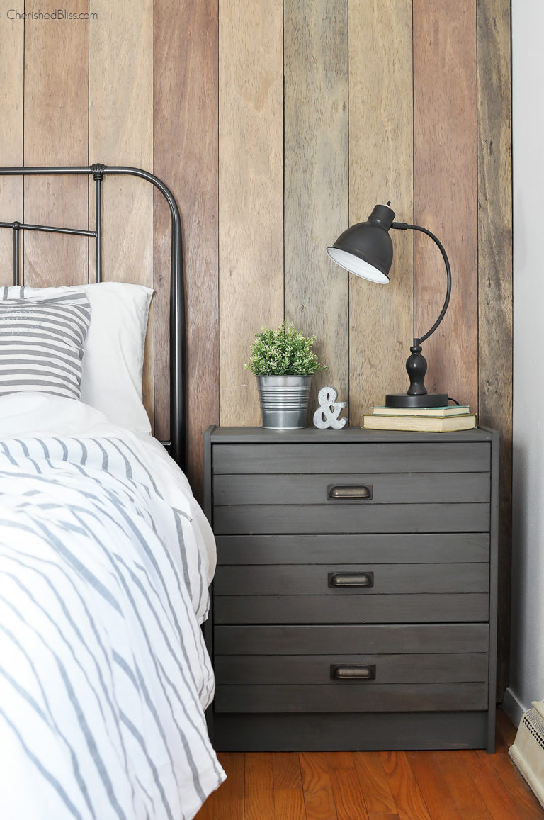 This gray industrial nightstand works great with the other shades of wood in the farmhouse room.