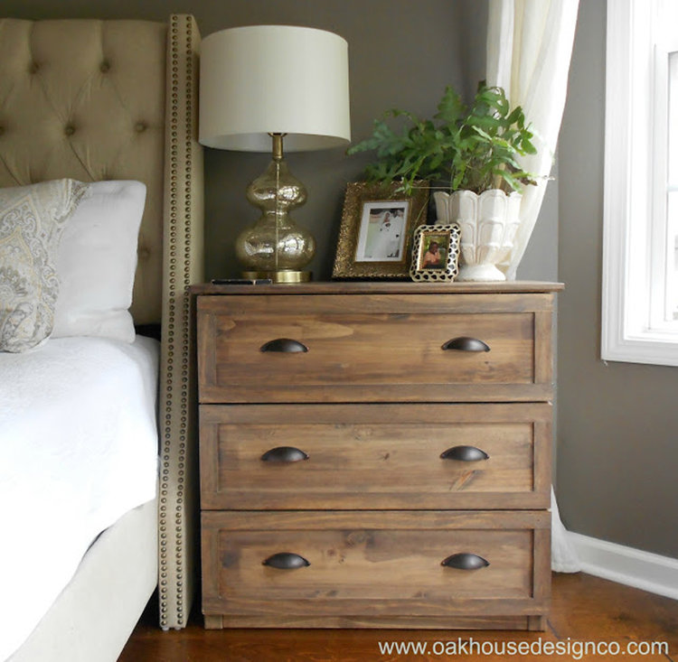 This light stained nightstand adds farmhouse flair to the modern room.