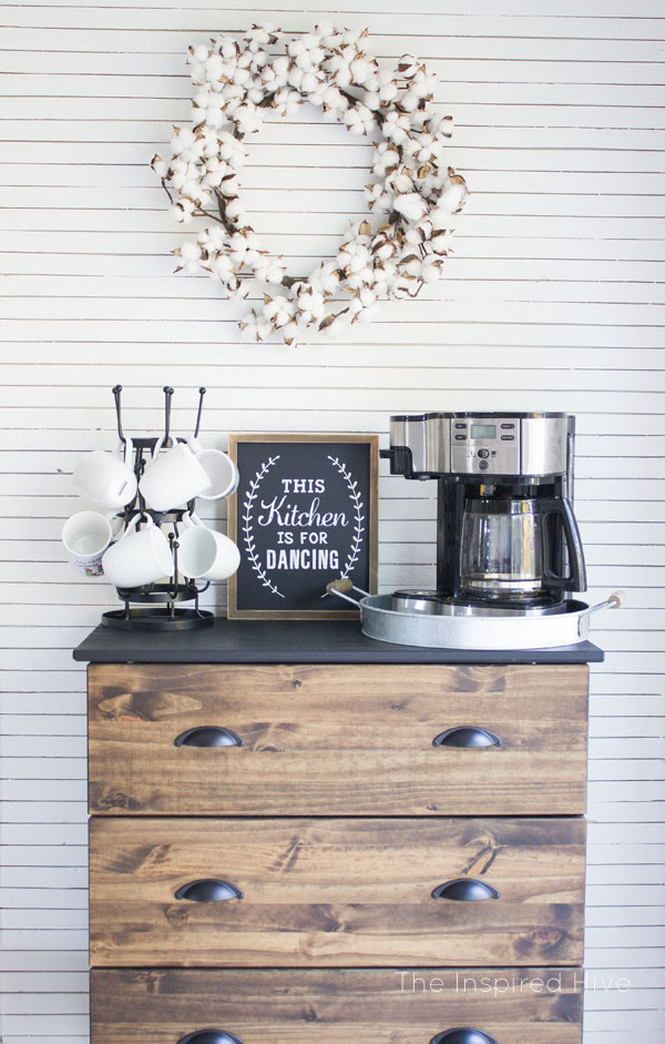 This coffee bar area evokes farmhouse with the shiplap drawers and cotton wreath.