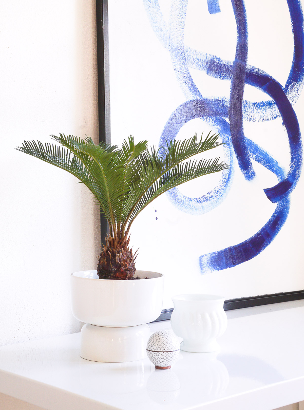 Sleek planters are easy to design and style into any room for a modern touch, like these IKEA planters